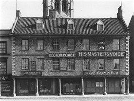 Photo:Coyne's Music Shop in the old moot Hall on the north side of Newark Market Place (The tower of the parish church of St.Mary Magdalene may be seen behind)