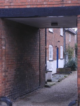 Photo:View through the archway between Nos.11 and 15 Church Street showing the yard and 18th century cottages beyond.  A possible location for Bingham's first theatre.