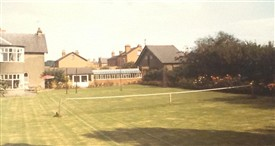 Photo:The tennis lawn at 'Fenimore' in the 1960s