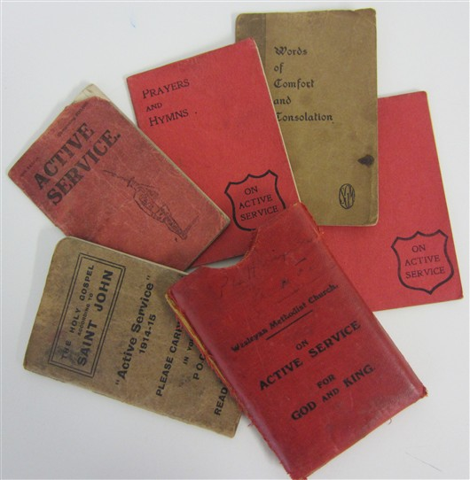 Photo:Five booklets (and protective wallet) given to soldiers by the Wesleyan Methodist Church - carried by Pte Dixon during his time at the front