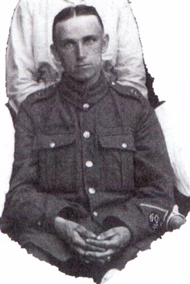 Photo:Detail from the group photo above:  So hasty was Pte Bell's return from the front mud from the trenches may be clearly seen on his hands