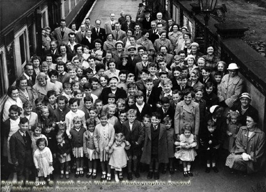 Photo:A happy group of children and adults at (we believe) Newark's Northgate railway station in the 1950s.  Are you in the picture?  Can you help us identify anyone seen here, and what was the reason for the outing?