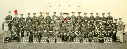 Photo:The Sherwood Foresters Regimental band with Bandmaster Arthur Frederick Coyne (front row middle, between drums).  Behind him is Frank Coyne, whilst Len Coyne is second from the left on the back row (with red spot above).
