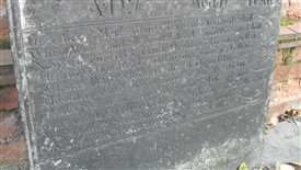 Photo:Tom Booth's epitaph, as transcribed in the text (left)