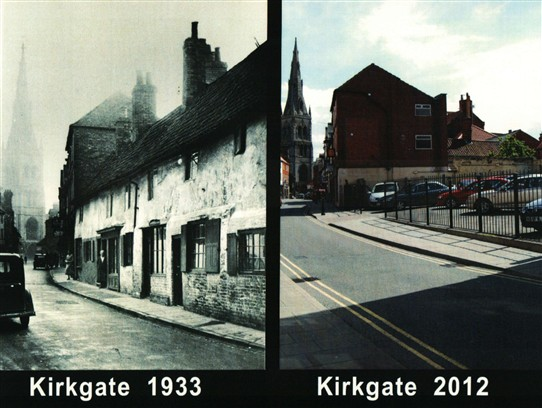Photo:Our photo (right) shows that a used car lot has replaced the old cottages from 1933.